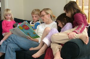 495427_mother_reading_a_book_to_kids
